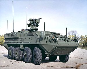 Materiel like this Stryker armored combat vehicle is backing up in Kuwait due to inadequate contractor support.