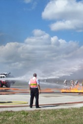 DynCorp, Coulson Group Form Global Aerial Firefighting Team; Jim Myles, Wayne Coulson Comment - top government contractors - best government contracting event