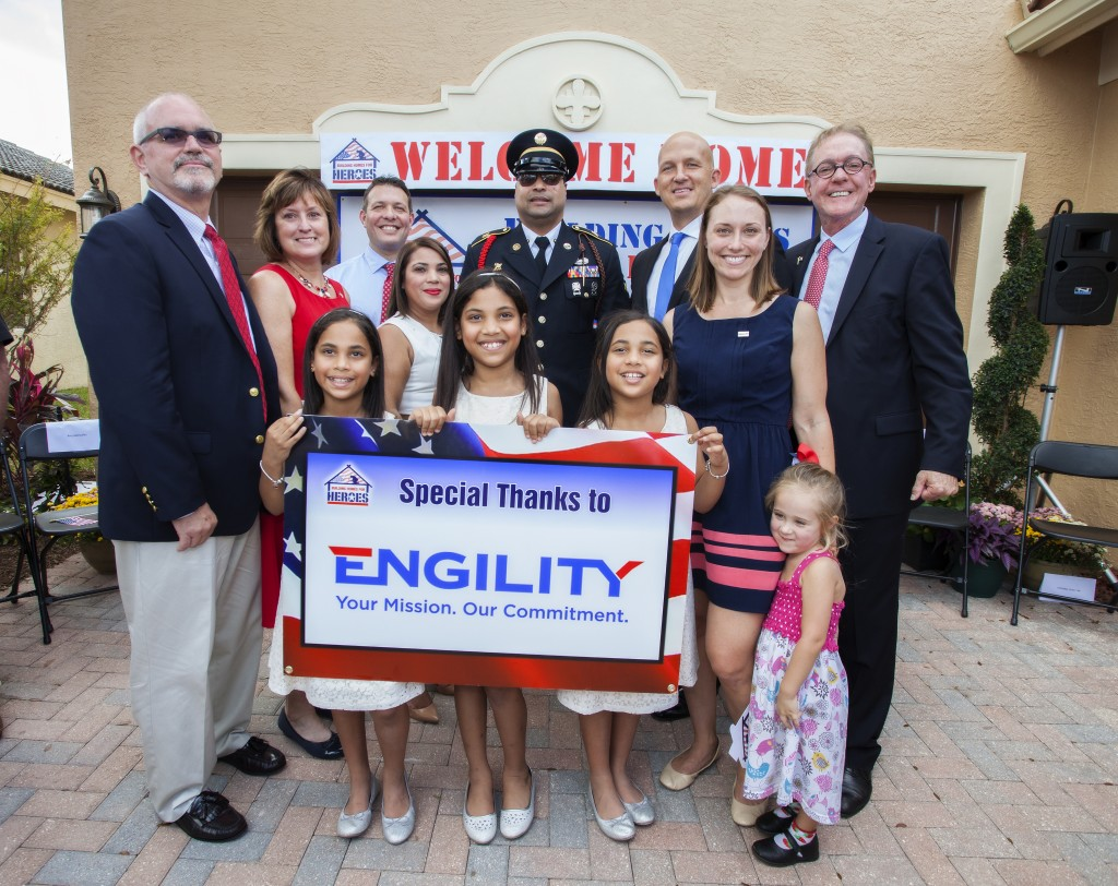 (Pictured Left to Right): Engility SVP of the Army Division John Murray, Cynthia Murray, BHH Director of Construction Chad Gottlieb, Home recipient Any Gonzalez, U.S. Army Specialist and home recipient Hugo Gonzalez (accompanied by three daughters), Mayor of Port St. Lucie, Fla. Gregory J. Oravec, President and Founder of BHH Andy Pujol, Engility representative Ashley Prince, and Grace Prince. Photograph courtesy of Gary DeJidas.