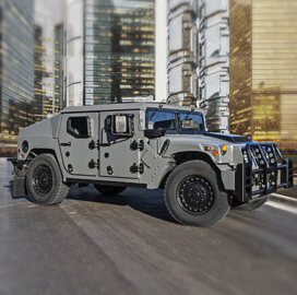 AM General Displays Next Generation Light Tactical Vehicle, Howitzer Kit at Eurosatory - top government contractors - best government contracting event