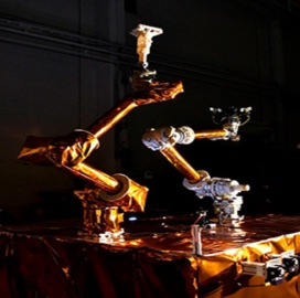 DARPA Reviews Satellite Servicing Robot Design - top government contractors - best government contracting event